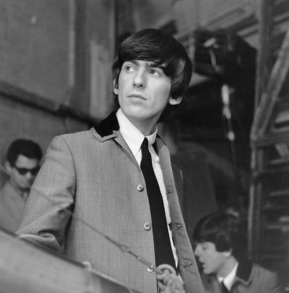 George Harrison and Paul McCartney on the set of A Hard Day's Night, 1964.
