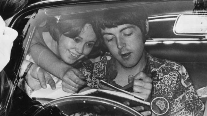 Paul McCartney signing an autograph from his car, 1965.