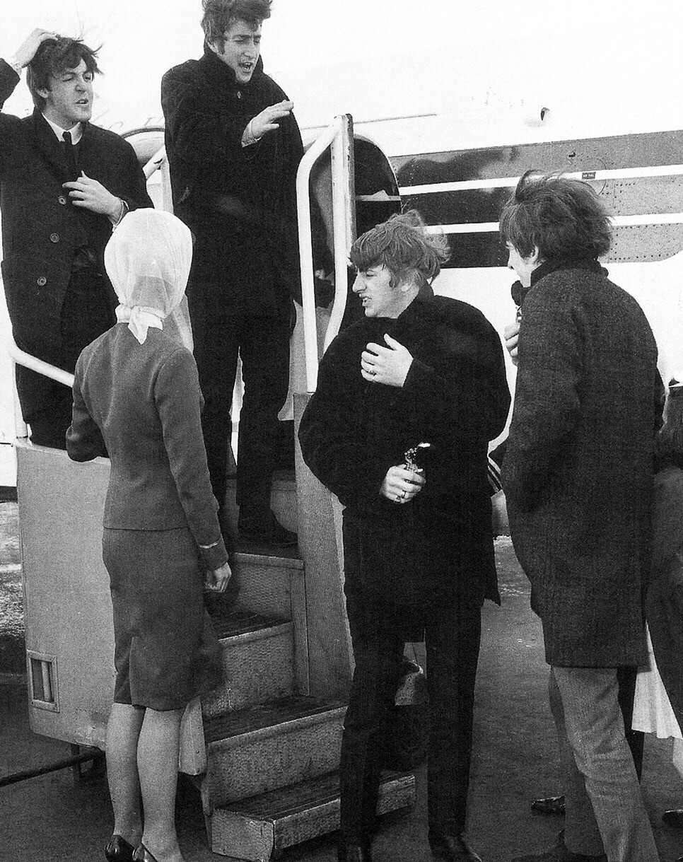 The Beatles getting off an airplane, 1964.