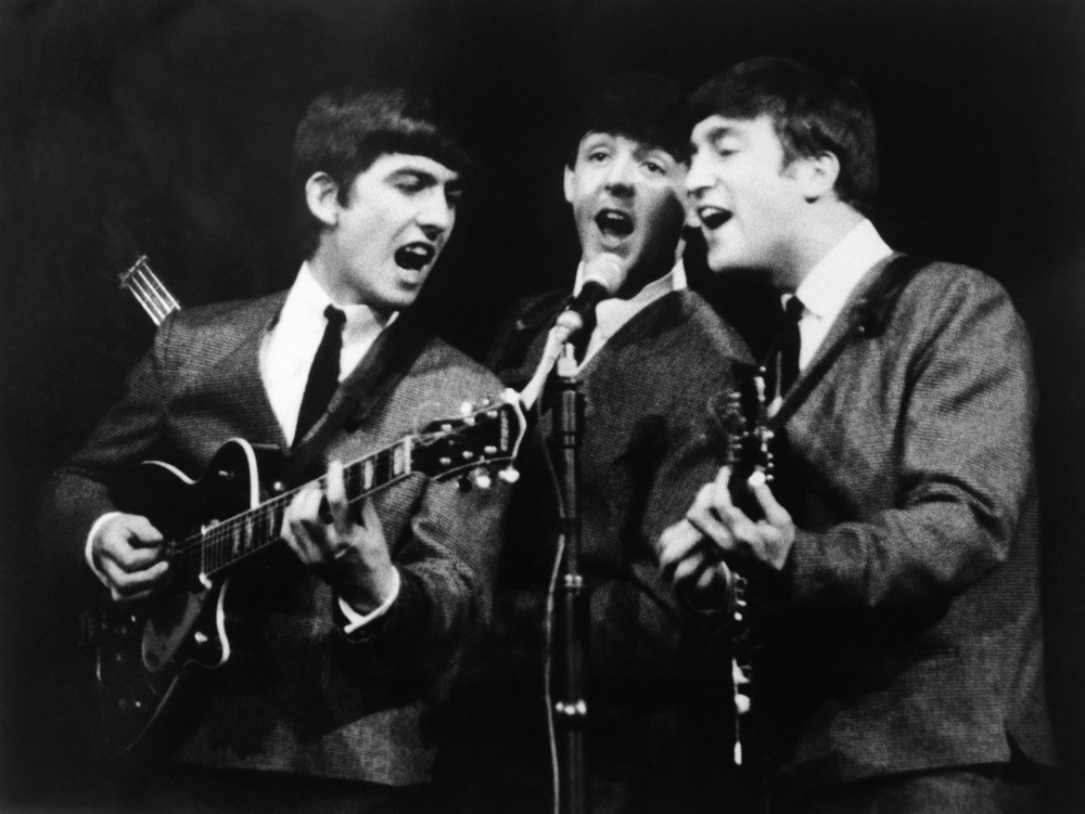 George Harrison, John Lennon and Paul McCartney singing three part harmony, 1963.