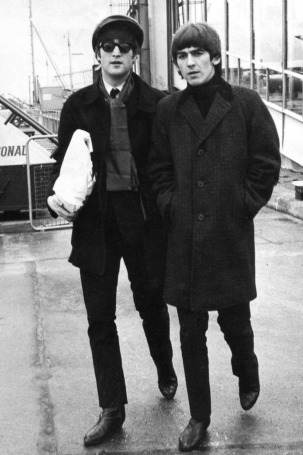 John Lennon and George Harrison, 1964.