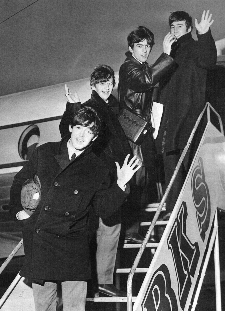 The Beatles getting on a plane, 1964.
