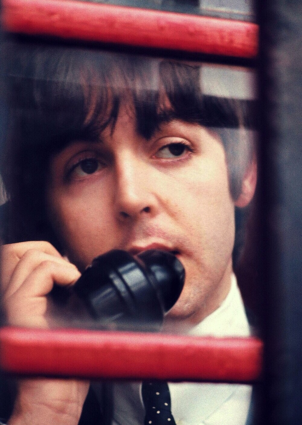 Paul McCartney on the phone, circa 1965.