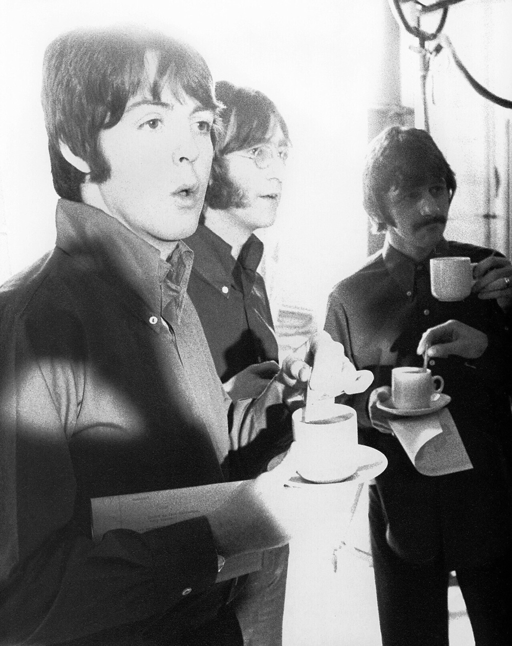 Paul McCartney, John Lennon and Ringo Starr enjoying tea and biscuits, 1968.