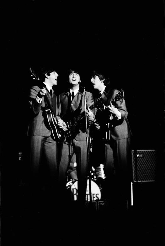 Paul McCartney, John Lennon and George Harrison singing harmony, 1963.