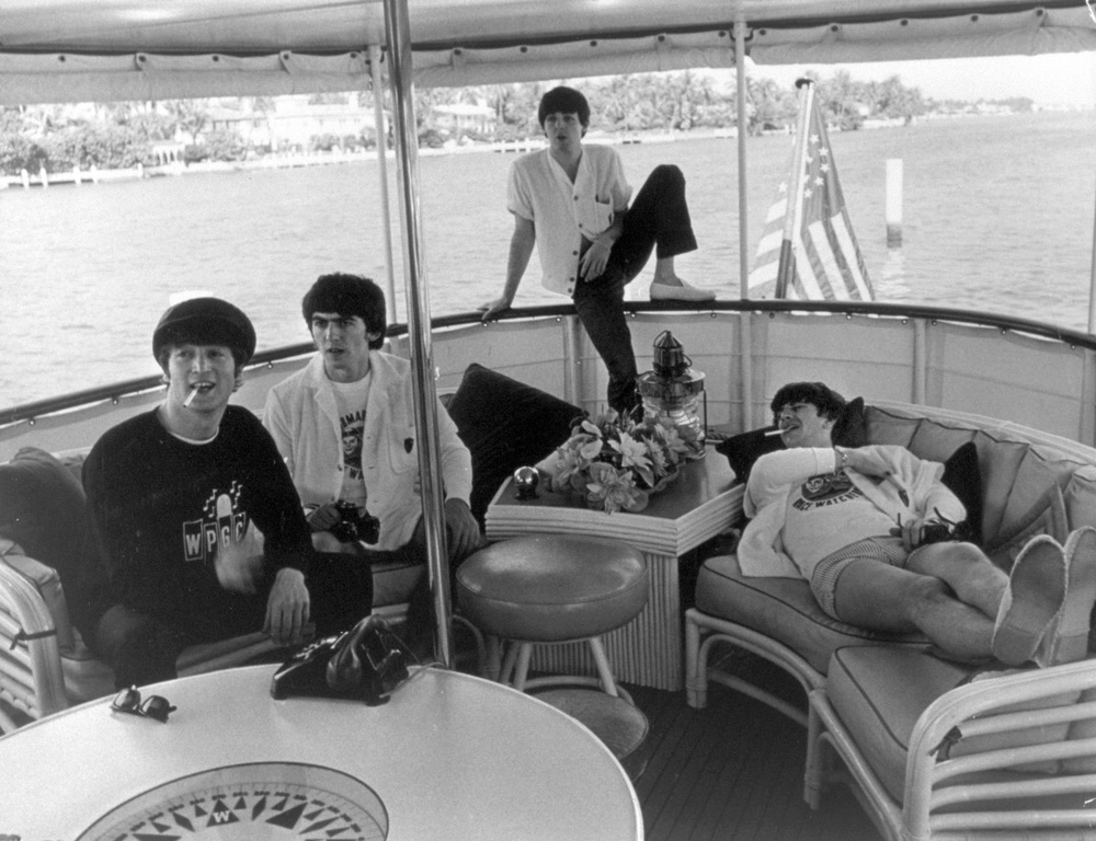 The Beatles on a boat in Miami, 1964.