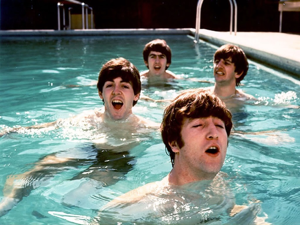 The Beatles in a swimming pool in Miami, 1964.