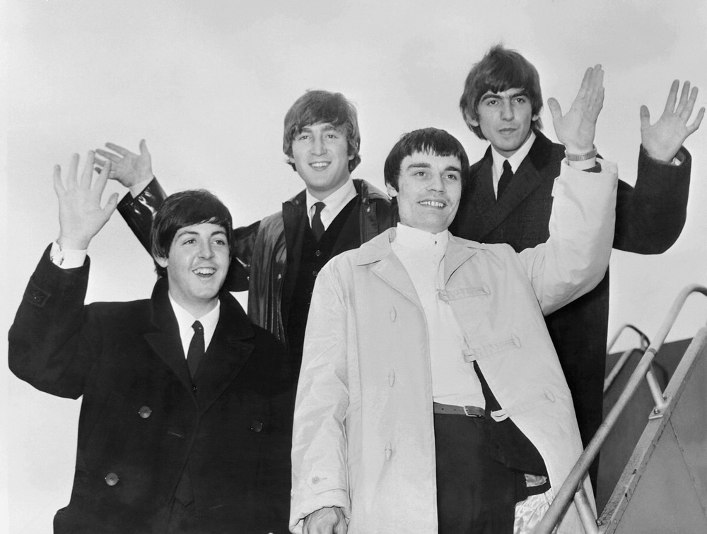 The Beatles leaving London with Jimmie Nicol, 1964.