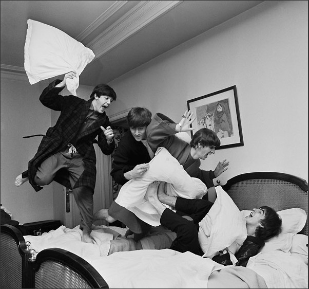 The Beatles having a pillow fight in Paris, January 1964.