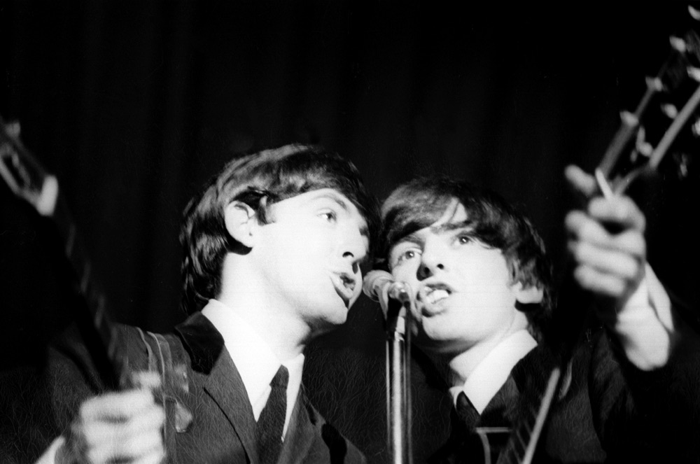 Paul McCartney and George Harrison on the Beatles UK tour, 1963.
