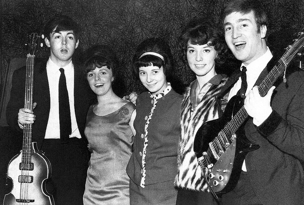 Paul McCartney and John Lennon with three lucky fans, 1963.