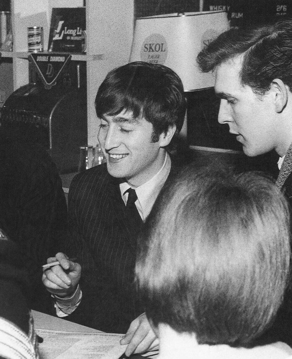John Lennon signing autographs, 1964.