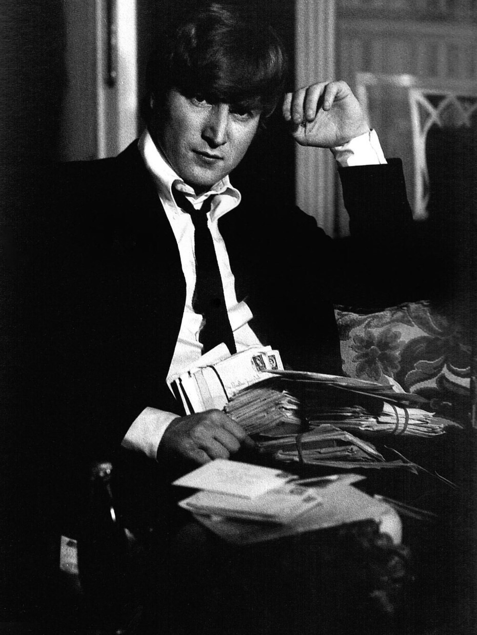 John Lennon reading fan mail, 1964.