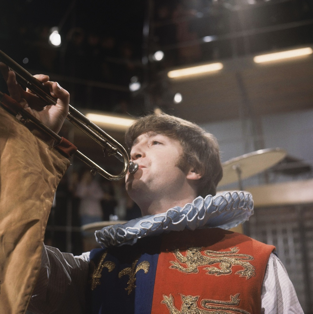 John Lennon celebrating Shakespeare's 400th birthday at Rediffusion's Wembley Studios, London, April 28th, 1964.