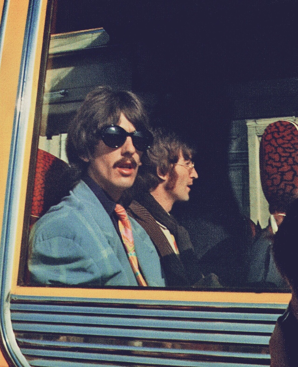 George Harrison and John Lennon aboard the Magical Mystery Tour bus, 1967.