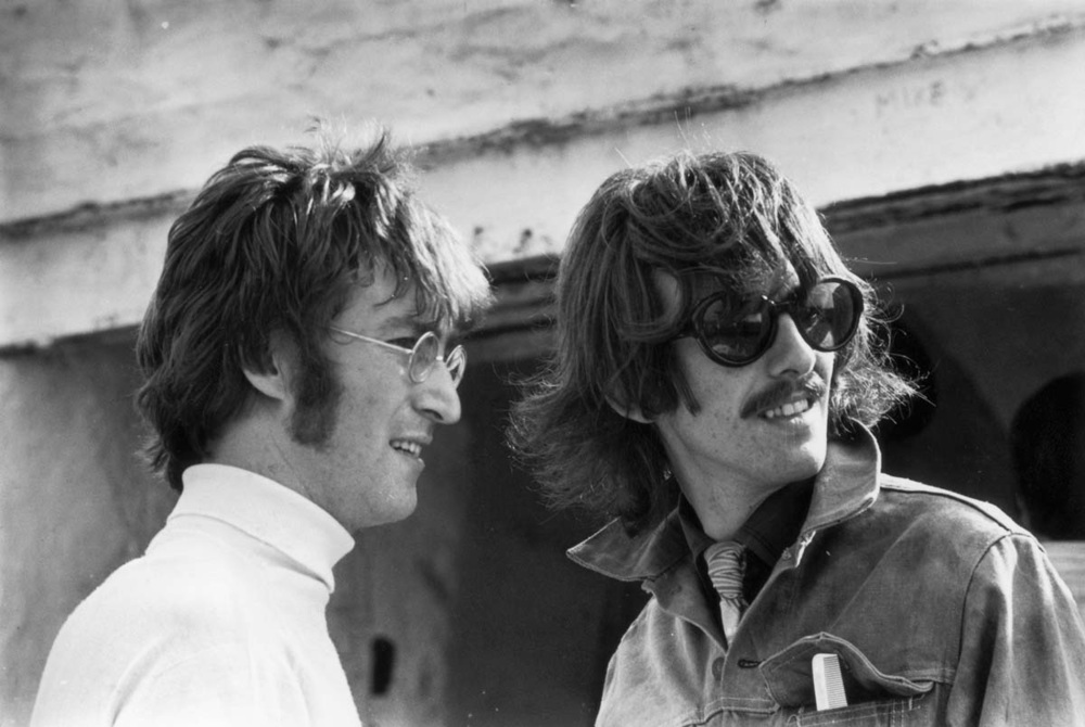 George Harrison and John Lennon on the set of Magical Mystery Tour, 1967.