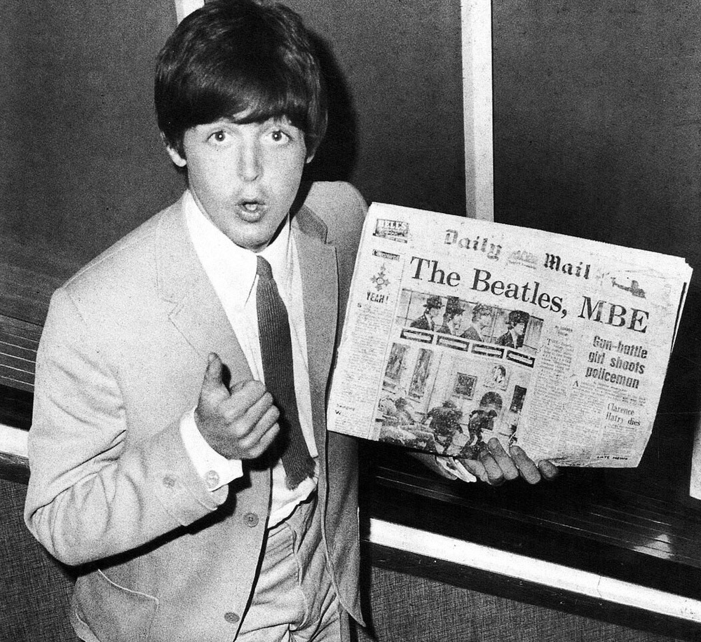 Paul McCartney with the Daily Mail newspaper, 1965.