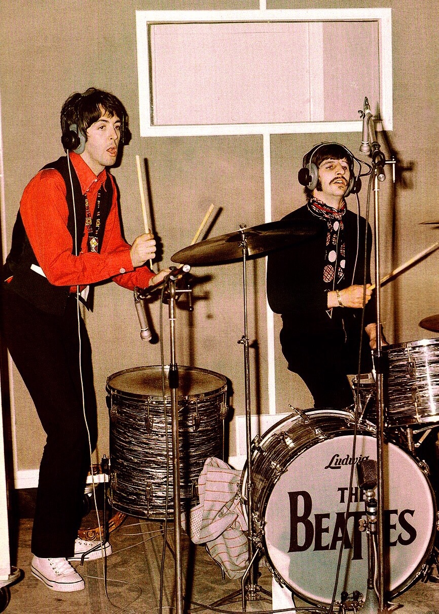 Paul McCartney and Ringo Starr playing drums, 1967.