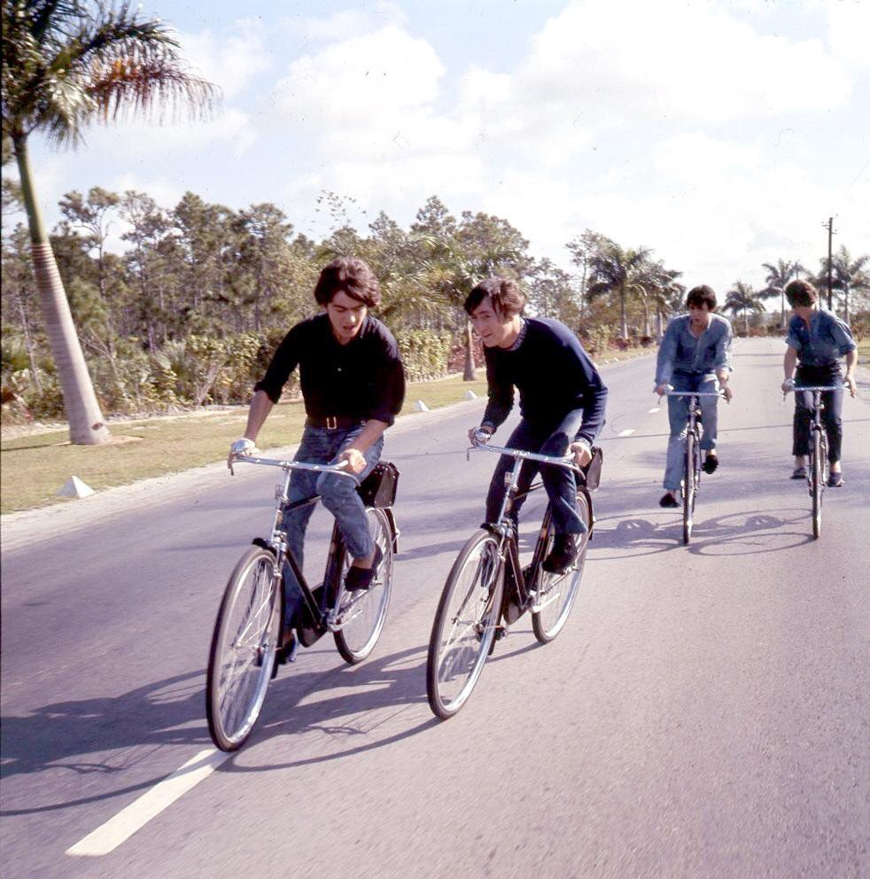 The Beatles riding bikes in the Bahamas, 1965.