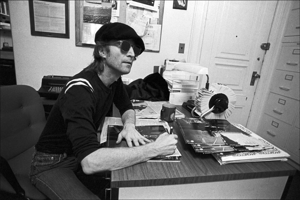 John Lennon signing copies of Double Fantasy, 1980.