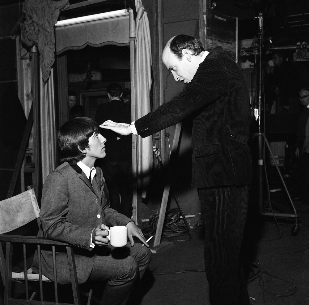 George Harrison and Dick Lester on the set of A Hard Day's Night, 1964.