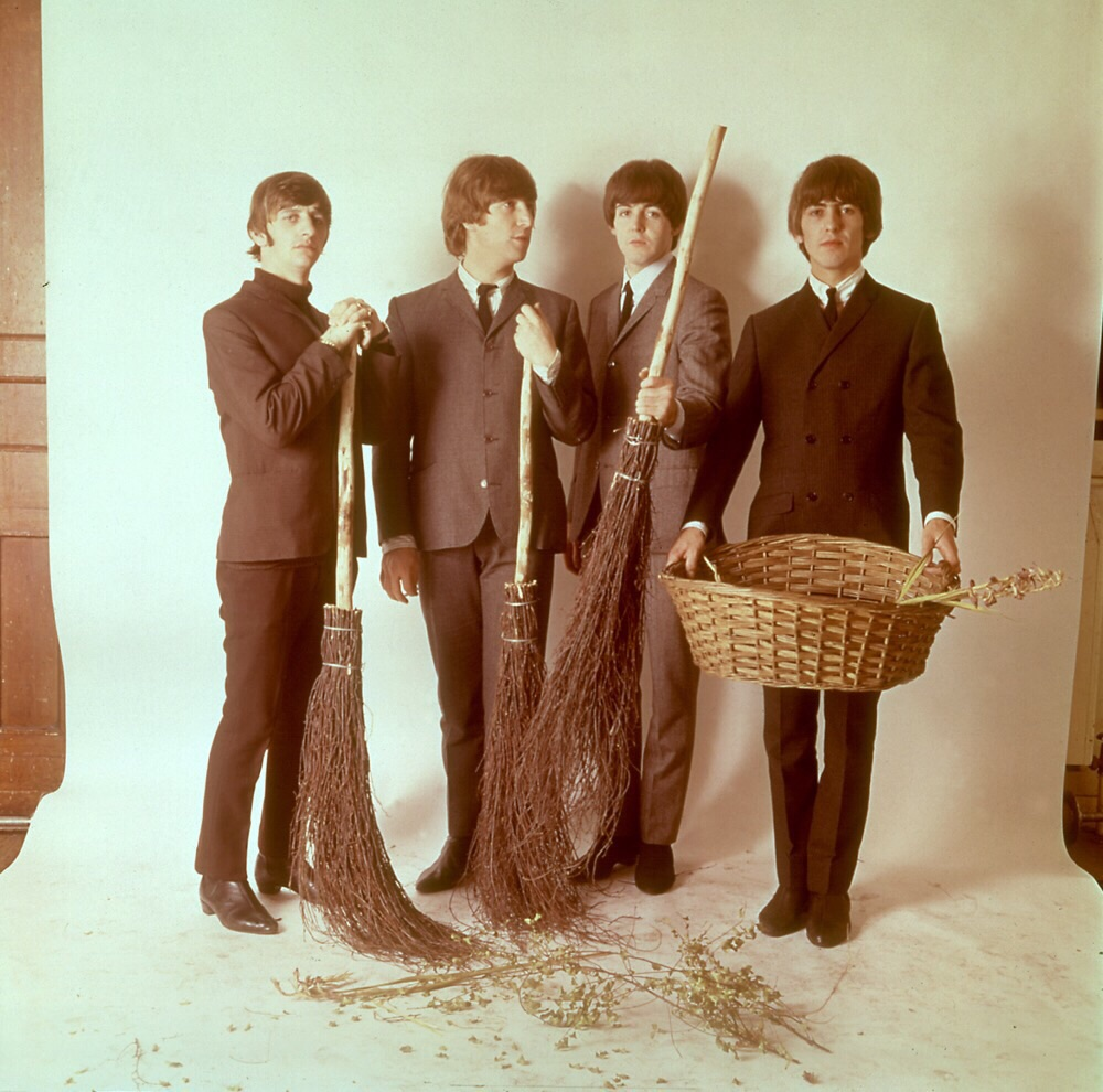 The Beatles with broomsticks, 1965.