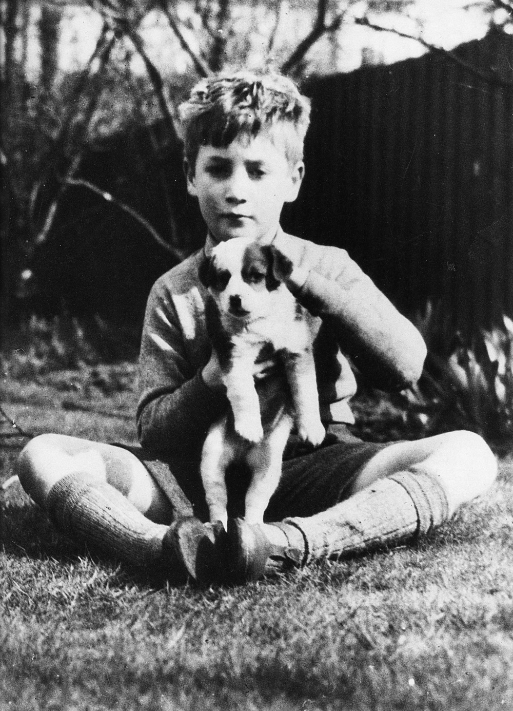 Young John Lennon with his dog.