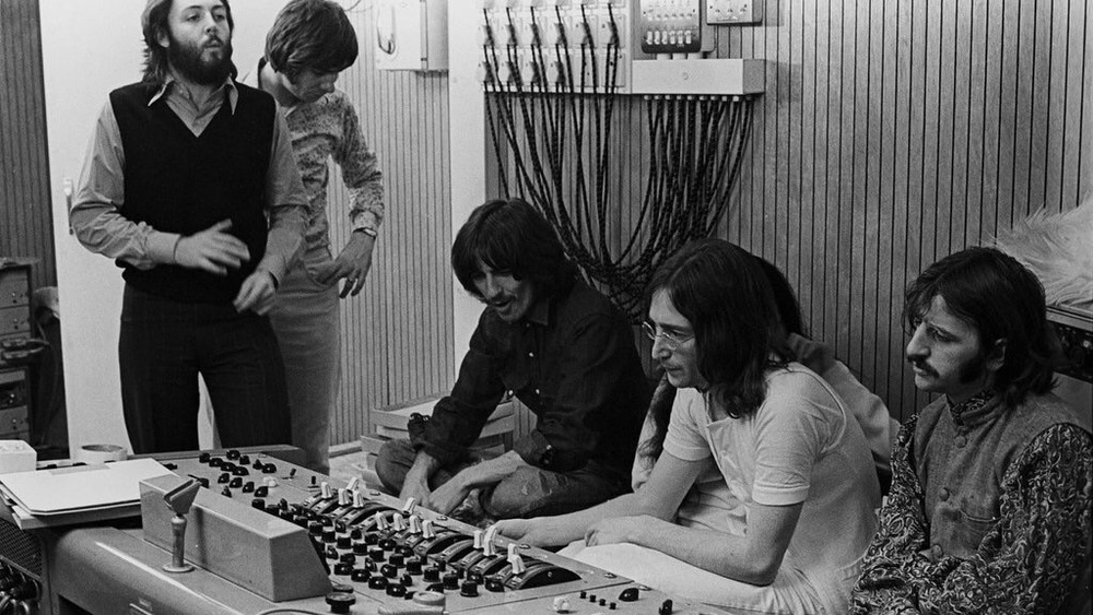 The Beatles working in Let It Be, 1969.