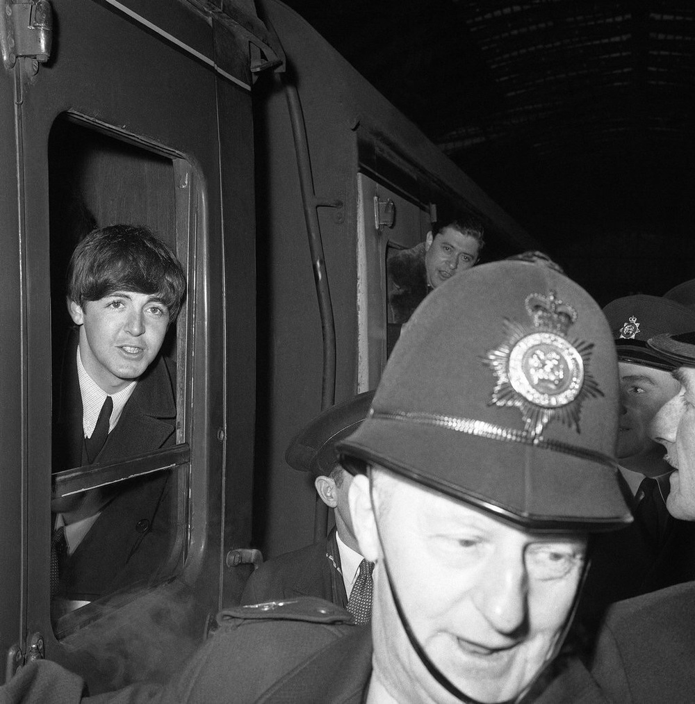 Paul McCartney at Paddington Station, London, March 1964.