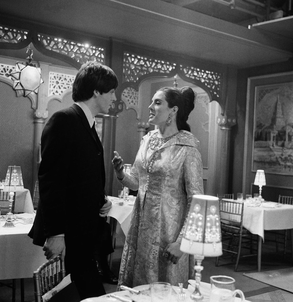 Paul McCartney on the set of Help! with actress Eleanor Bron, 1965.