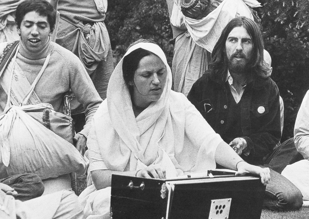 George Harrison with members of the Hindu sect Radha Krishna Temple, 1969.