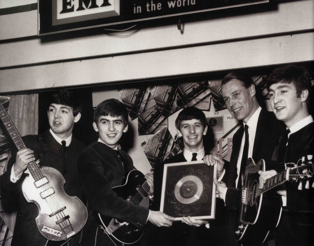 The Beatles receiving a silver disc for Please Please Me, 1963.