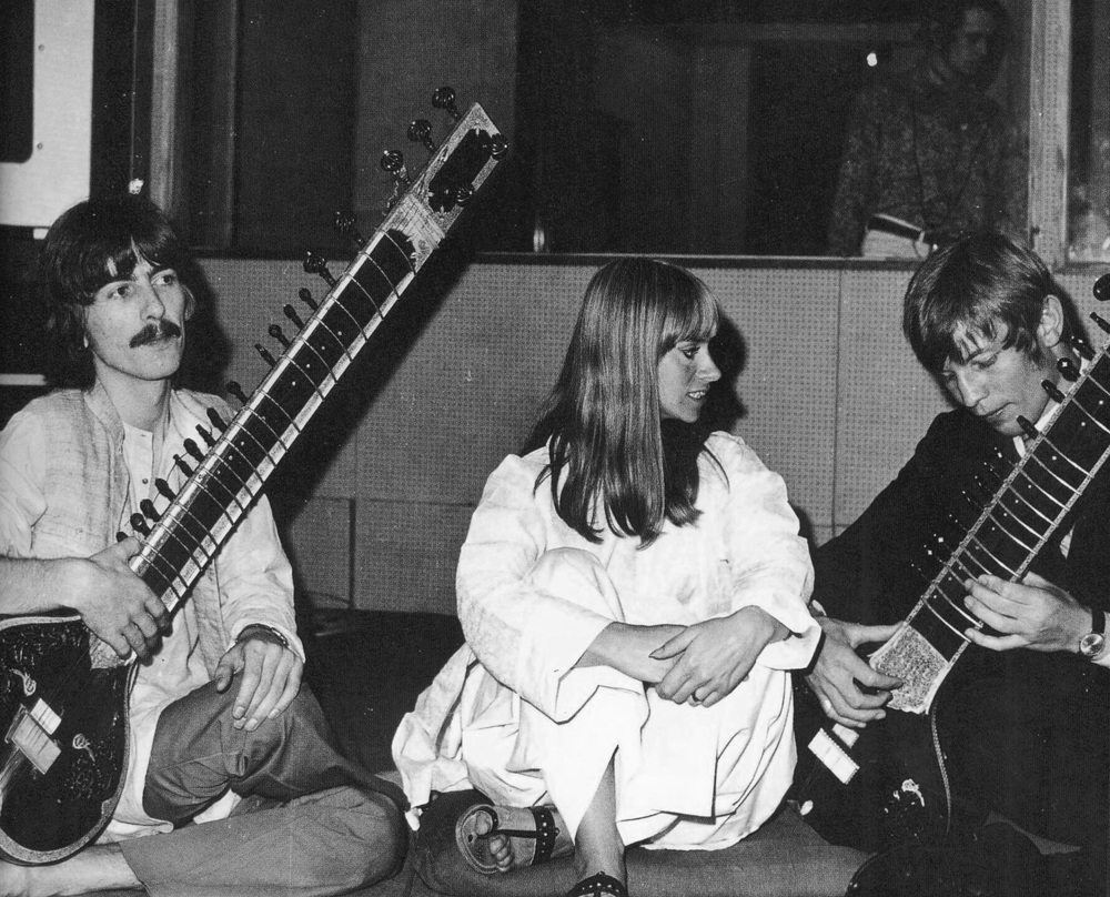 George Harrison practising sitar with actress Rita Tushingham and Michael York, 1967.