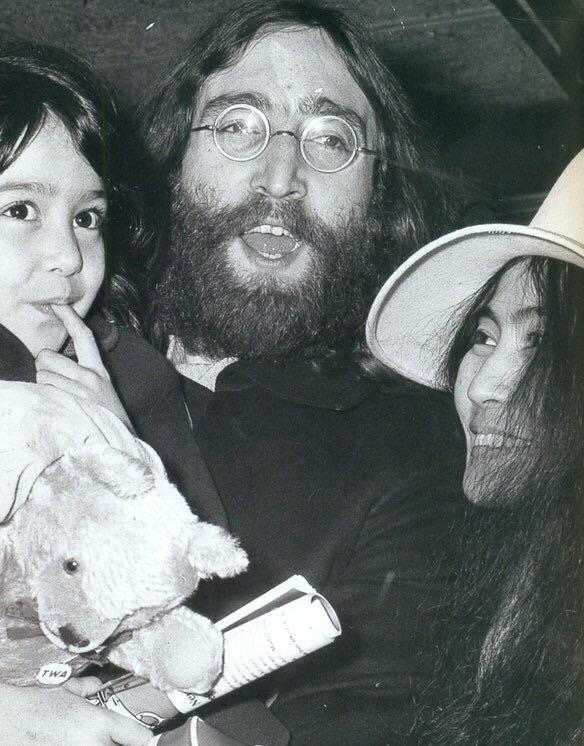 John Lennon with Kyoko and Yoko Ono, 1969.