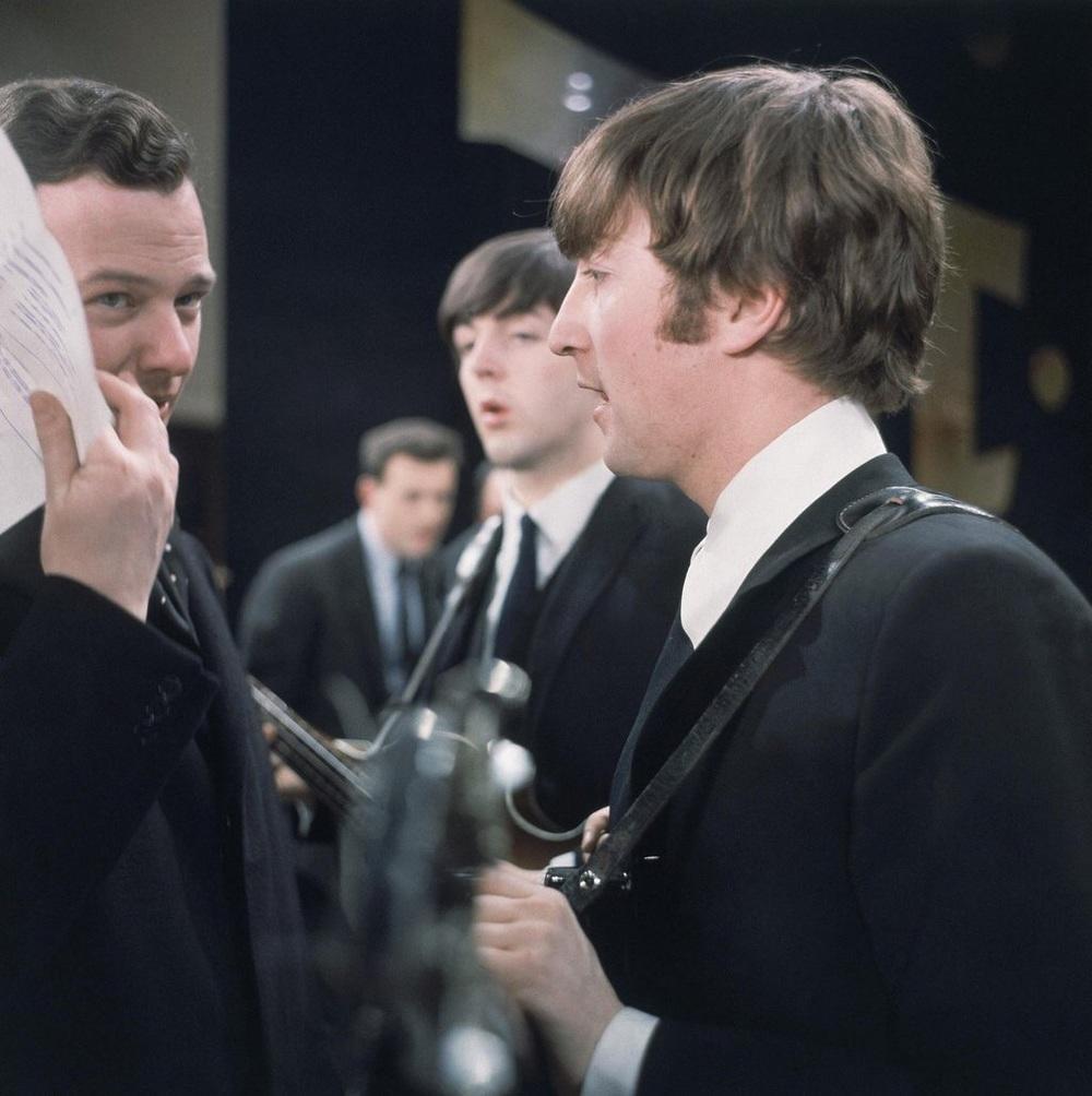 John Lennon, Paul McCartney and Brian Epstein at a rehearsal for the Ed Sullivan show, 1964.