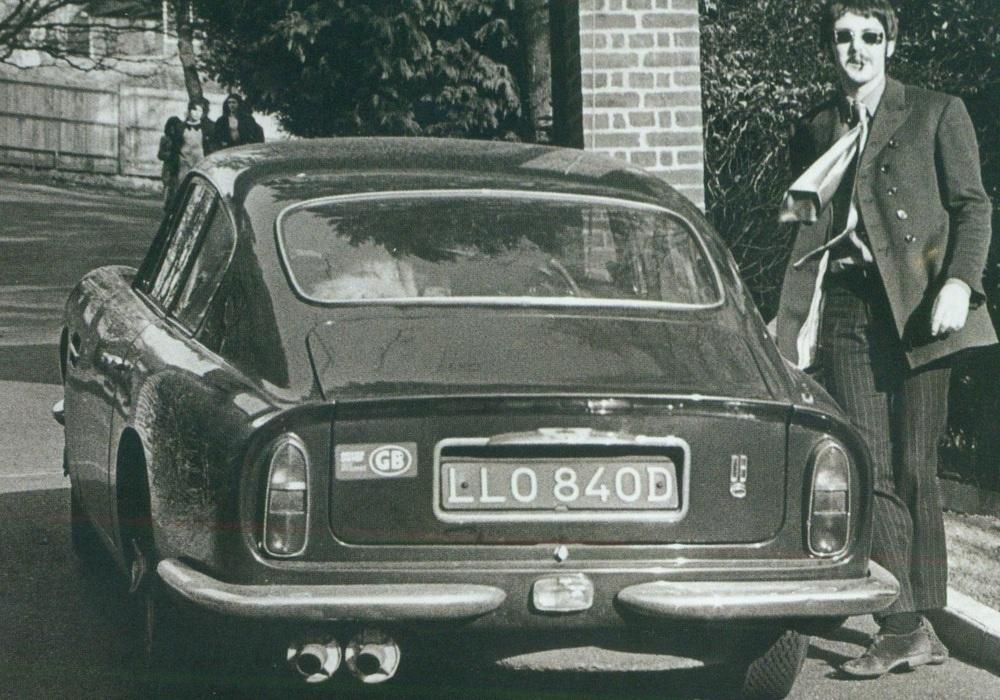 Paul McCartney with his Aston Martin, 1967.