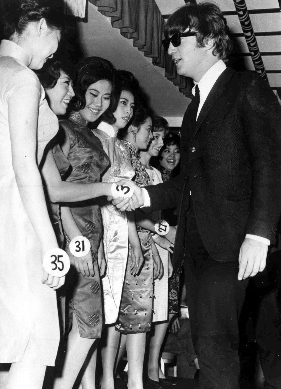 John Lennon judging a beauty contest, 1964.
