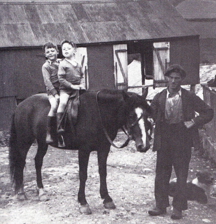 Paul McCartney on horseback with his younger brother Michael.