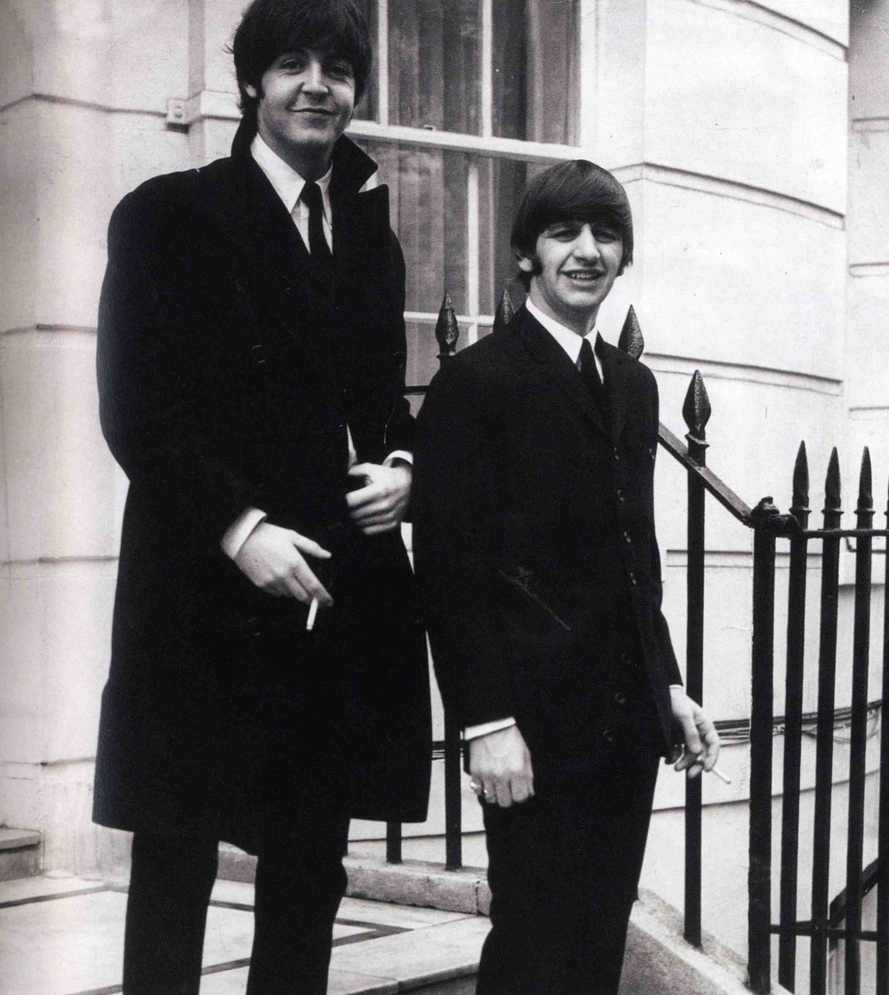 Paul McCartney and Ringo Starr leaving to pick up their MBEs, October 26th 1965.