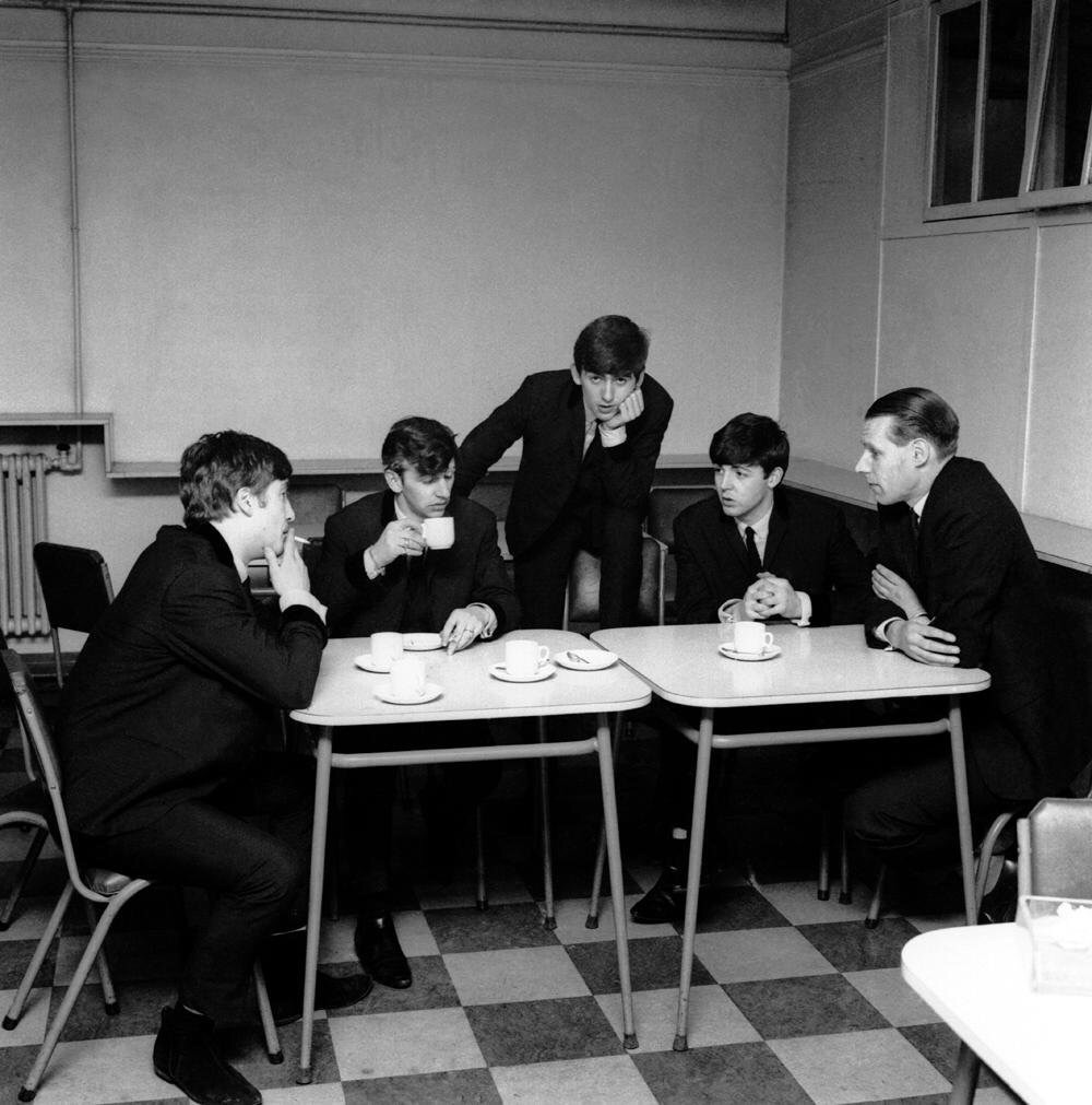 The Beatles with producer George Martin at Abbey Road, 1962.