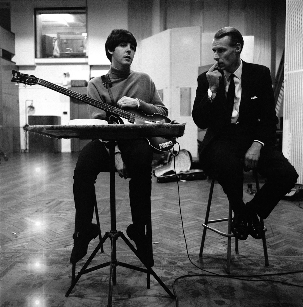 Paul McCartney and George Martin during a Beatles for Sale recording session, 1964.