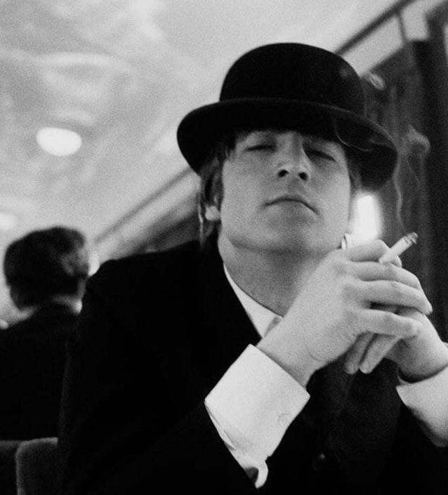 John Lennon on a train, 1964. Photo by Astrid Kirchherr.