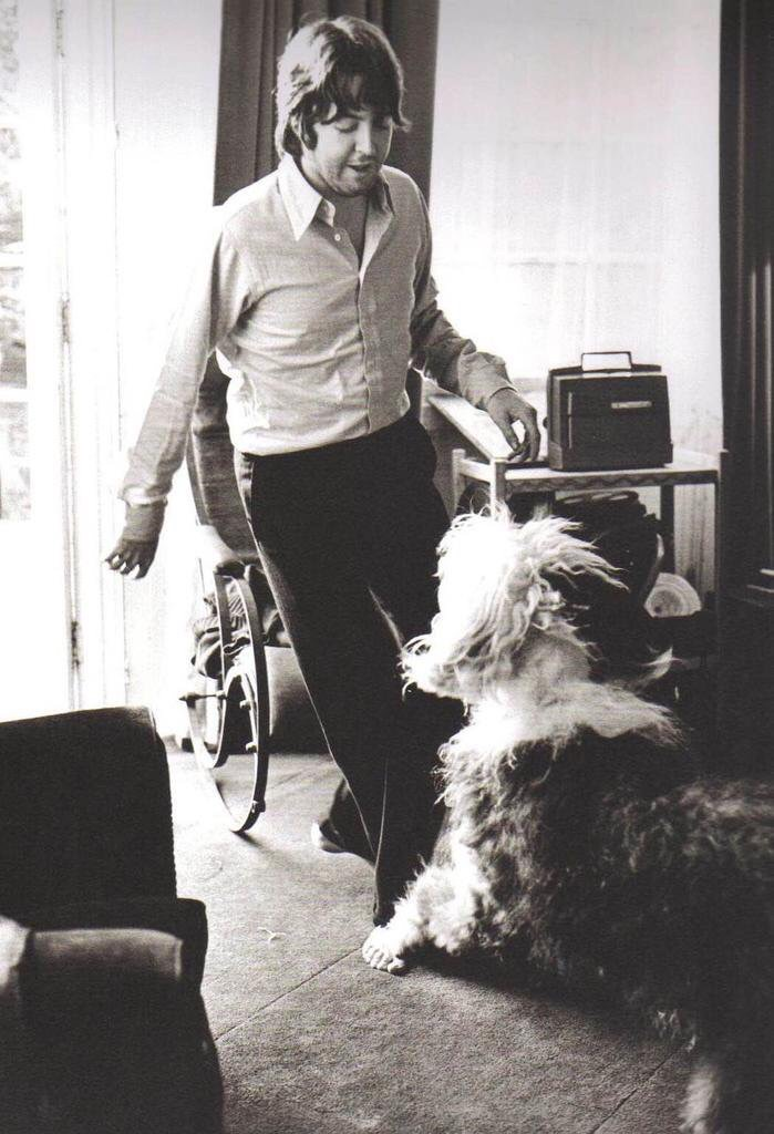 Paul McCartney with his sheepdog Martha, 1968.