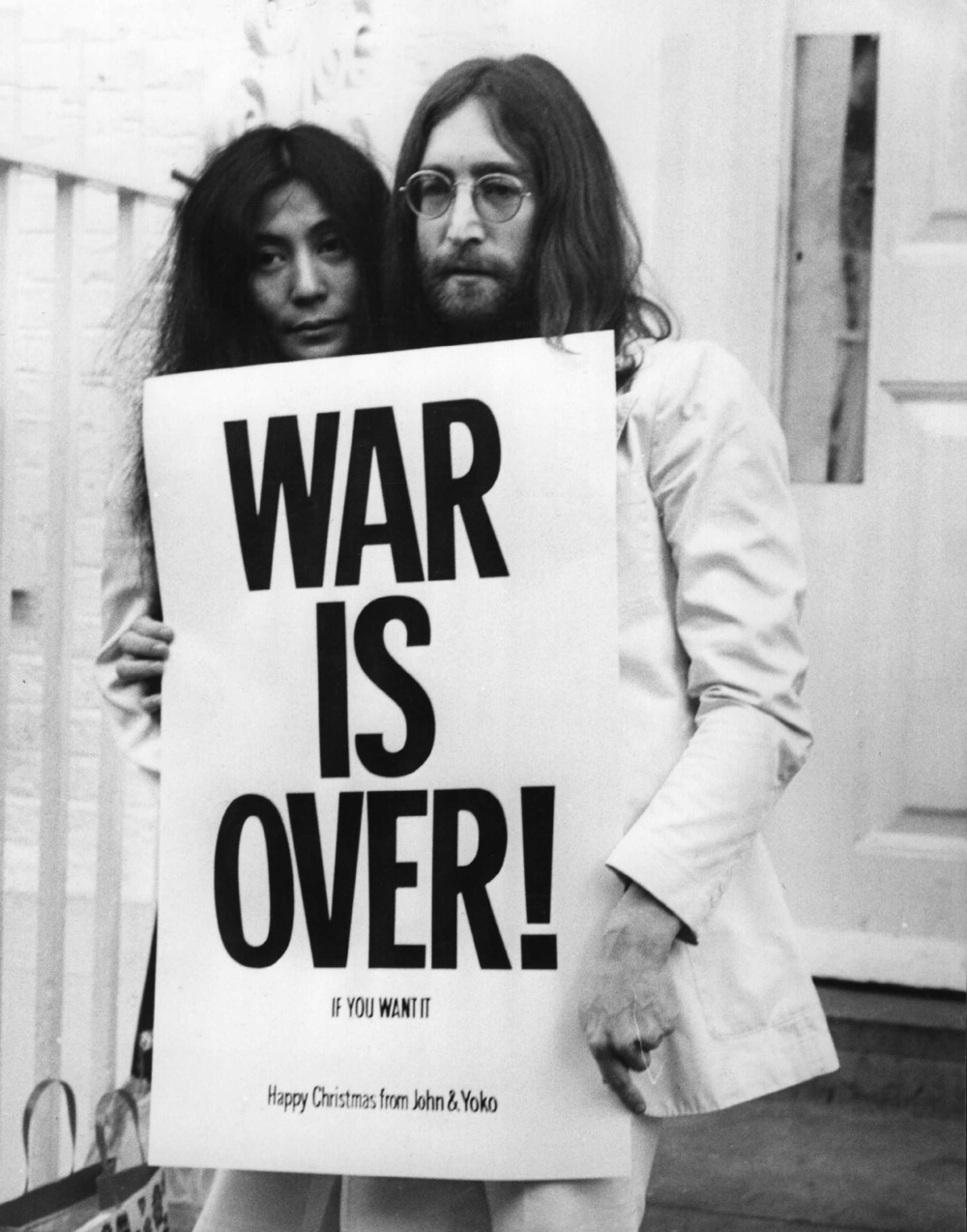 John Lennon and Yoko Ono holding their War Is Over peace message, 1969.