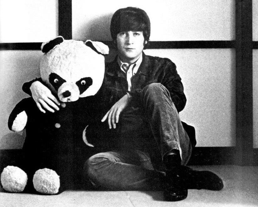 John Lennon with a newly purchased panda bear for his son Julian, 1964.