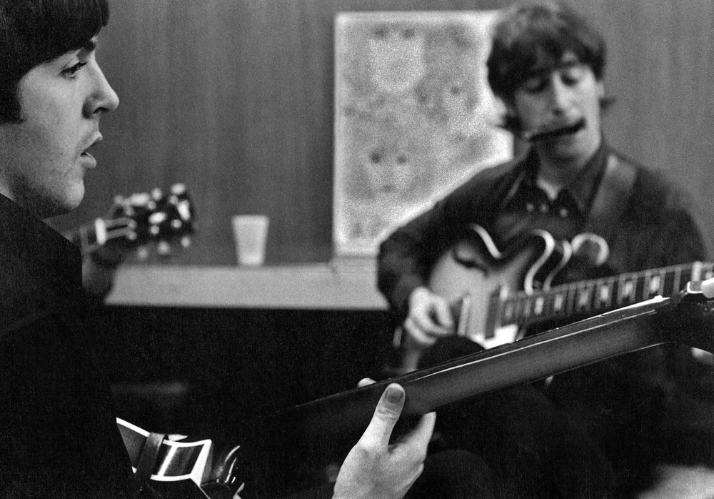 John Lennon and Paul McCartney backstage, 1966. Photo by Bob Bonis.