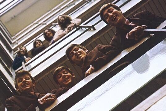 The Beatles at the headquarters of EMI Limited, 20 Manchester Square, London, 1963 and 1969.