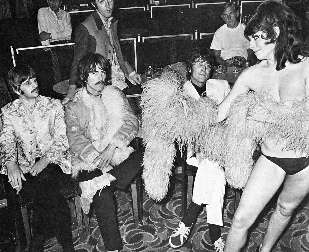 The Beatles with a female dancer during the filming of Magical Mystery Tour, 1967.