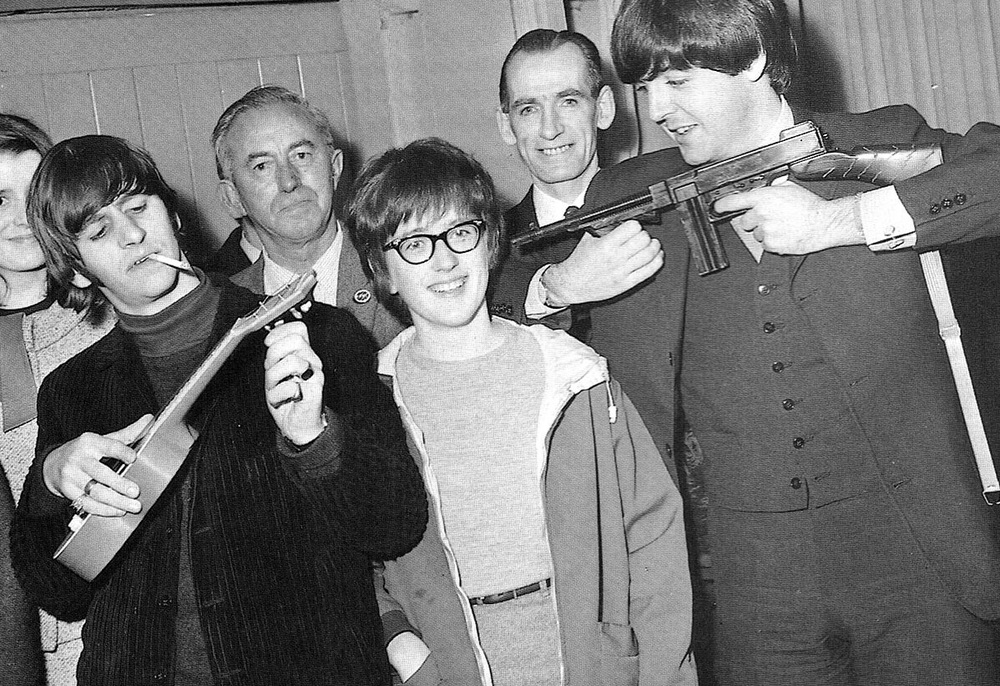 Paul McCartney and Ringo Starr with some Beatles' fans, 1964.