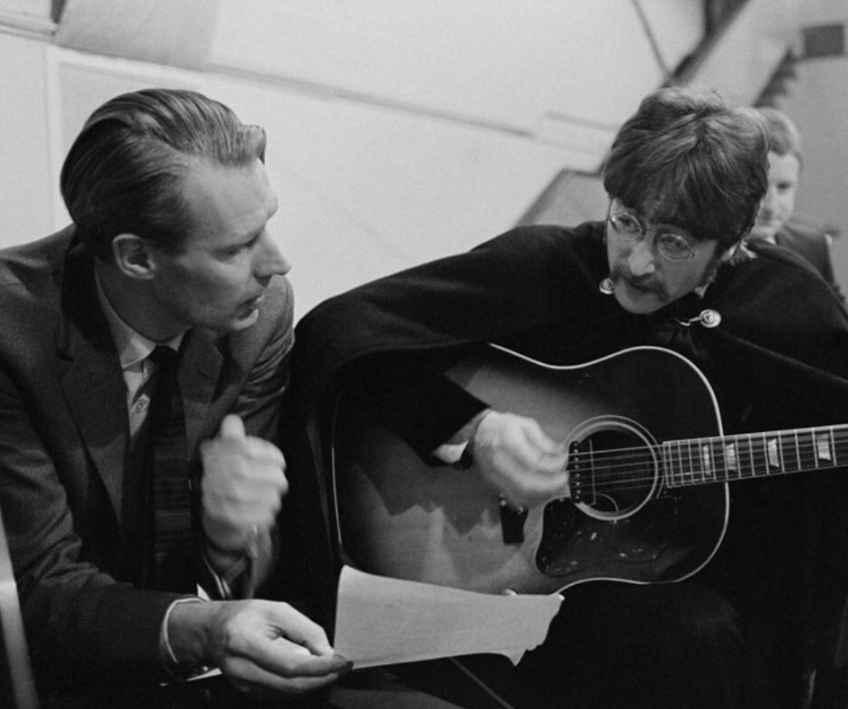 John Lennon and George Martin during the recording of Sgt. Pepper's Lonely Hearts Club Band, 1967.